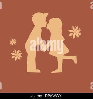 Ein Junge und ein Mädchen küssen Stockbild