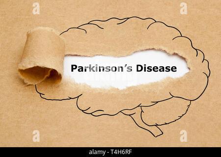Konzept mit Text Parkinson erscheinen hinter zerrissen braunes Papier mit menschlichen Gehirn Zeichnung. Stockbild