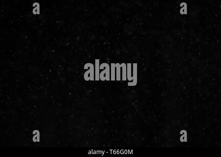 Abstrakte echten Staub schweben über schwarzen Hintergrund Stockbild