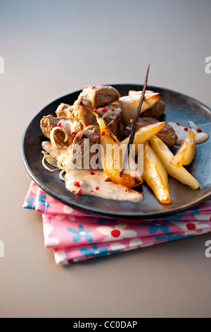 Saut?ed Wildschwein mit Birne und Vanille-Chutney Stockbild