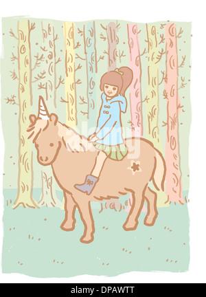 Ein Mädchen auf einem Einhorn Stockbild