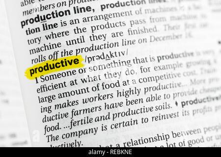 """Hervorgehobene englische Wort """"produktiv"""" und seiner Definition im Wörterbuch. Stockbild"""