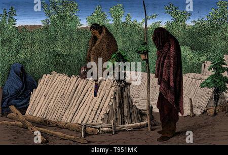 """Chippewa oder Ojibwe Gräber und Trauernde, in ein Fest für die Toten, 1873. Vor der nächsten Grab ist das Grab post gesehen, mit Blättern und einem Behälter für Angebote es gebunden. Am Ende des hölzernen Struktur für das Grab ist ein Loch für das Einfügen von Angeboten von Nahrung, und Oben ist es mit Blättern verziert. An der Seite hing das arbeitete Messer - Fall des Verstorbenen, und oben ist eine Kopfbedeckung der Federn."""" John William Dawson. Stockbild"""
