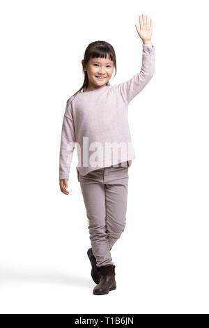 Niña feliz agitando la mano Imagen De Stock