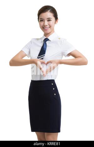 Retrato de sonriente azafata de aerolíneas Imagen De Stock