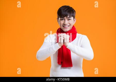 Joven alegre saludo de año nuevo chino Imagen De Stock