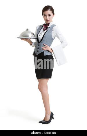Sonriente camarera en hotel con bandeja de servir Imagen De Stock