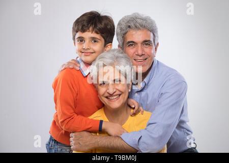 Retrato de abuelos y nieto Imagen De Stock