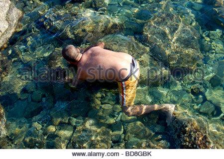Un buzo en Mykonos, Grecia Imagen De Stock