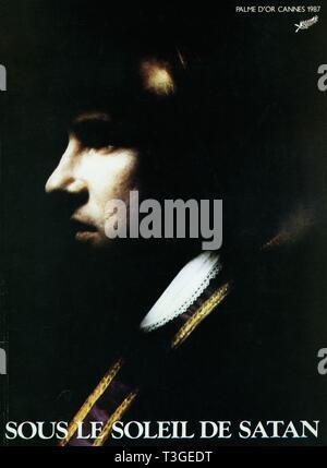 Bajo el sol de Satán Año: 1987 Director: Francia Maurice Pialat, Gerard Depardieu póster de película (Fr) la Palma de Oro en Cannes 1987 Imagen De Stock