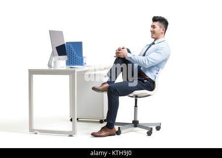 Joven empresario ejerce en Office Imagen De Stock