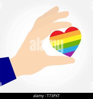 Mano sujetando un corazón en los colores de LGBT, diseño plano Imagen De Stock