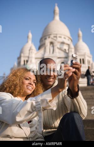 Pareja africana teniendo propia fotografía Imagen De Stock