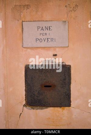 Pan para los pobres, la caridad de la iglesia, caja de la región del Veneto, Venecia, Italia Imagen De Stock