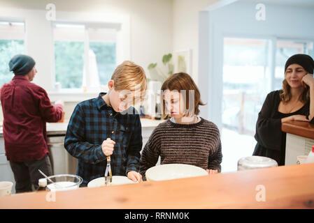 Family baking in kitchen Photo Stock