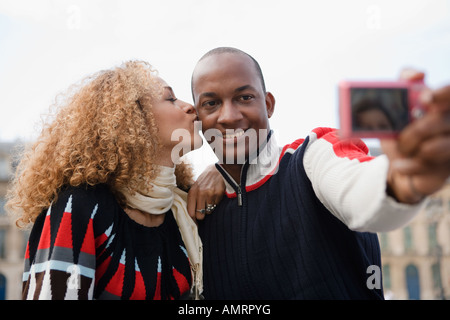 African couple taking own photograph Photo Stock