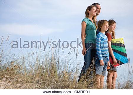 Famille avec un cerf-volant Photo Stock