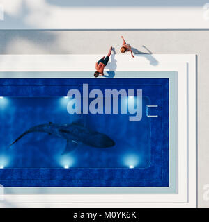 Couple watching shark in swimming pool Photo Stock