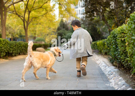 Little Boy running with dog Photo Stock