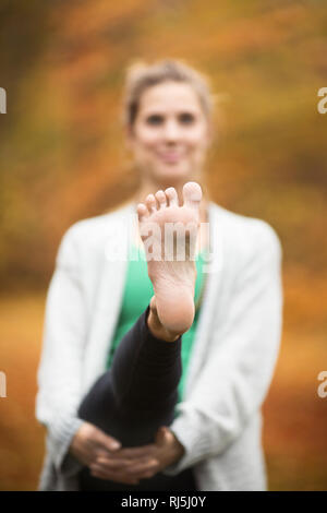 Young woman stretching Photo Stock