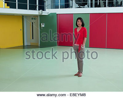 Smiling businesswoman in empty office Photo Stock