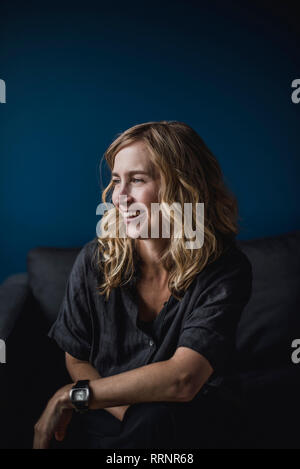 Portrait souriant, confiant woman looking away Photo Stock