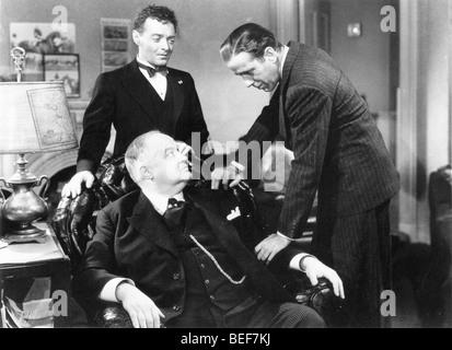 (L-R) Peter Lorre, Sydney Greenstreet, et HUMPHRY BOGART dans une scène du film 1941, 'Le Faucon Maltais'. Photo Stock