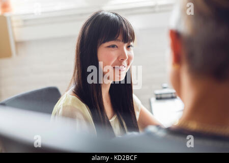 Man and Woman talking in office Photo Stock