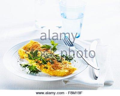 Omelette avec du persil frais Photo Stock
