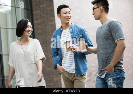 Cheerful young friends talking outdoors Photo Stock