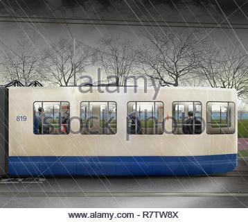 Les passagers voyageant en tramway sur jour de pluie Photo Stock