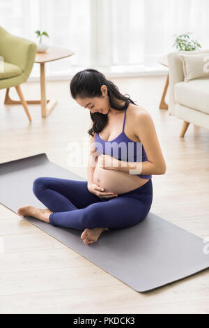 Pregnant woman touching belly Photo Stock