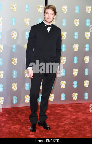 Londres, Royaume-Uni. 10 fév, 2019. Londres, Royaume-Uni. 10 février 2019 : Joe pour l'arrivée d'Alwyn BAFTA Film Awards 2019 au Royal Albert Hall, Londres. Photo : Steve Sav/Featureflash Crédit : Paul Smith/Alamy Live News Photo Stock