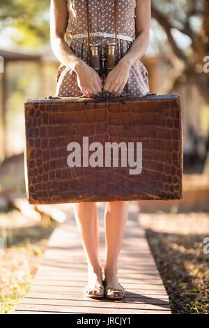 Senior woman holding briefcase Photo Stock
