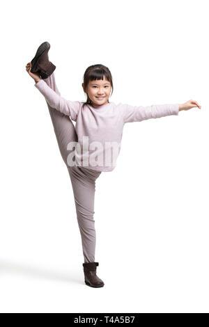 Happy little girl doing splits Photo Stock