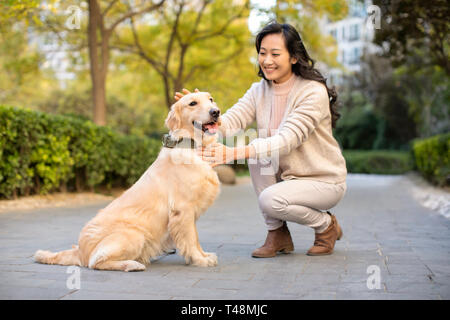 Happy young woman with dog Photo Stock