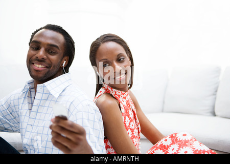 Couple listening to mp3 player ensemble Photo Stock