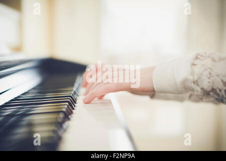 Close up of Caucasian girl playing piano Photo Stock