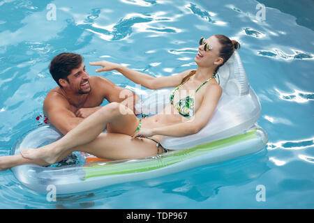 High view of happy Senior couple having fun together in swimming pool Photo Stock