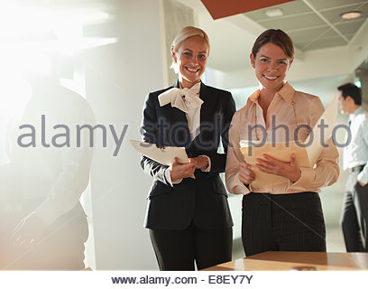 Businesswomen talking in office Photo Stock