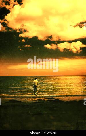 Young woman walking on beach Photo Stock