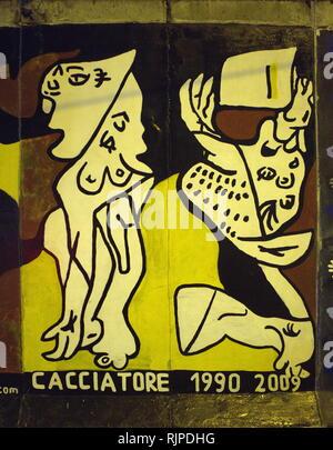 Une photographie d'une partie de l'art graffiti sur un panneau du mur de Berlin Photo Stock