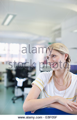 Businesswoman daydreaming in office Photo Stock