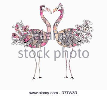 Face à face deux flamants roses en forme de coeur formant avec des plumes à motifs Photo Stock