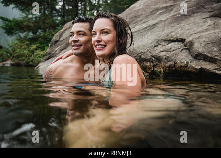 Young couple swimming in lake Photo Stock