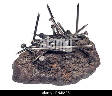 Attirer des clous de fer magnétite Photo Stock