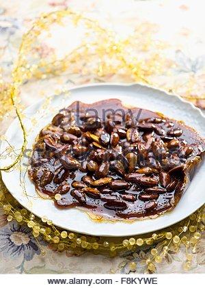 Les amandes dans le caramel Photo Stock