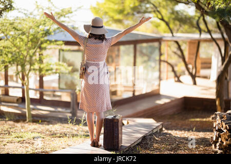 Senior woman standing with her arms wide open Photo Stock