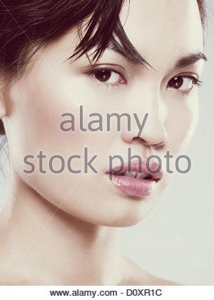 Young woman looking at camera Photo Stock