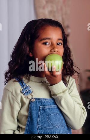 Young Girl eating apple M. © Myrleen ....Pearson Ferguson Cate Photo Stock